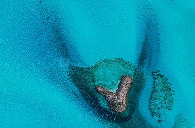 Aerial image showing the sea around sandbanks and islands in the Bahamas archipelago, Caribbean, February 2012