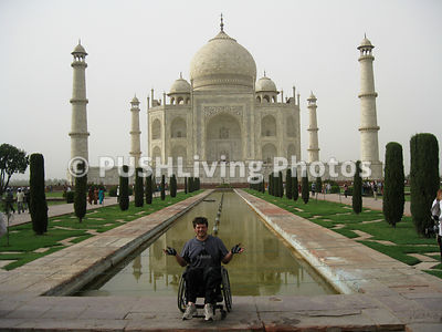 Man using a wheelchair at the Taj Mahail, India