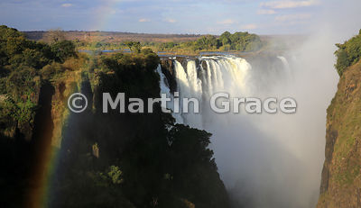 Main Falls with rainbow, photographed from the west in late afternoon sun, Victoria Falls, Zimbabwe and Zambia
