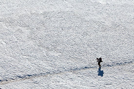 Thru-Hiker Crosses Snowfield on Pacific Crest Trail