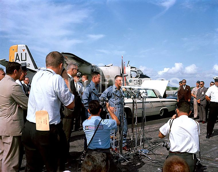 (24 March 1965) --- Astronauts Virgil I. Grissom and John W. Young stand before microphones at the Cape's skid strip during w...