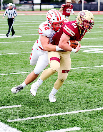 Coe College's Tyler Dralle (21) breaks towards the sideline as Central's Sam Norgaard (42) gives chase during the first half ...