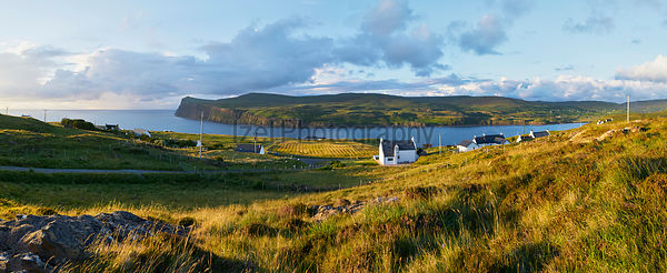 White painted houses of Milovaig at sunset overlooking Loch Pooltiel near Dunvegan on the Isle of Skye, Scotland, UK.