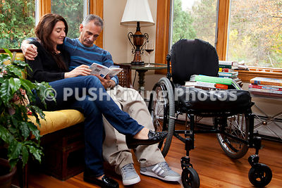 Man in a wheelchair at home on a cool Autumn afternoon