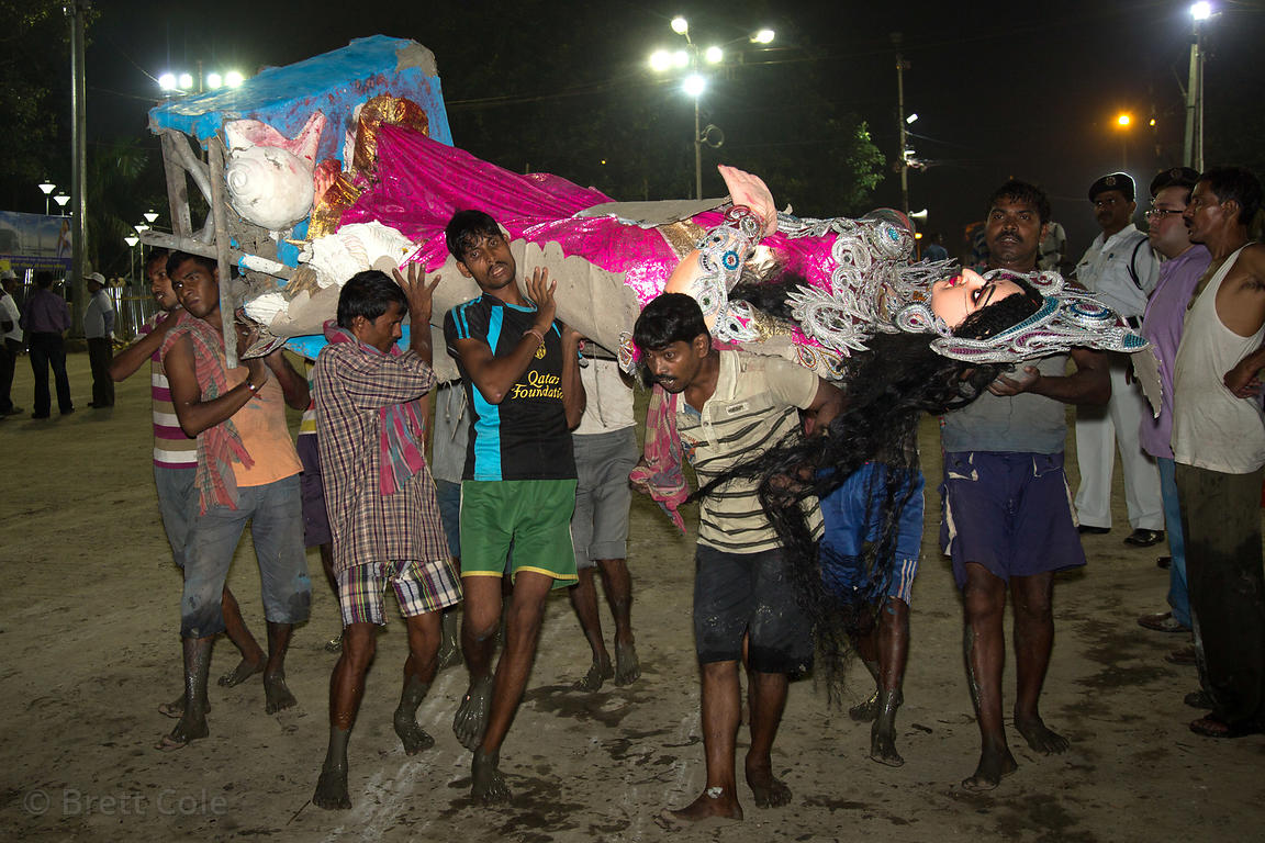 Durga idols are immersed in the Hooghly River during the Durga Puja festival, Babughat, Kolkata, India