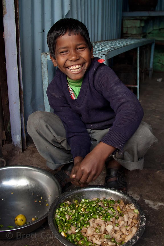 Boy making the filling for vegetable samosas in Bharatpur, Rajasthan, India
