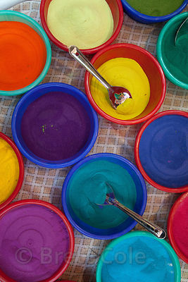 A stall selling colored gulal powders at a market in Shyambazar, Kolkata, India