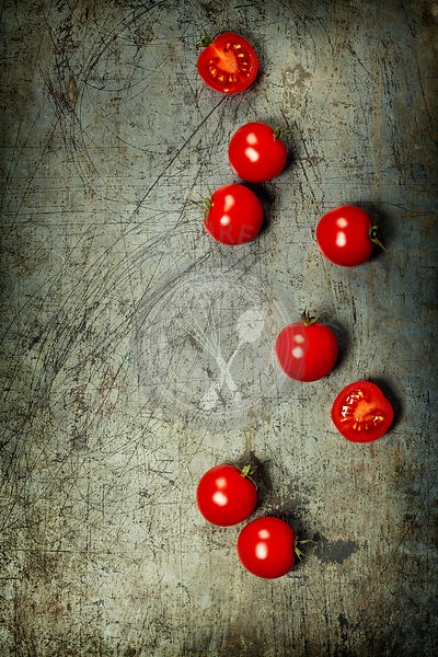 Fresh grape tomatoes on rustic background