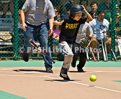 Young Batter Running to First Base