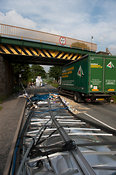 Articulated wagon passing under low railway bridge has roof of trailer ripped off. Kirkby Stephen, Cumbria