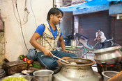 India - Delhi - A man serving Nihari (a meat stew) at the Ghaffar nihari wallah, Old Delhi