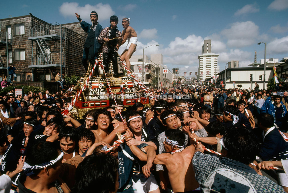 Crush of merrymakers accompanies the mikoshi, a portable Shinto shrine, through San Francisco's Japantown during the Cherry B...