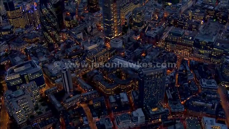 Aerial footage of the City of London at night, England, UK