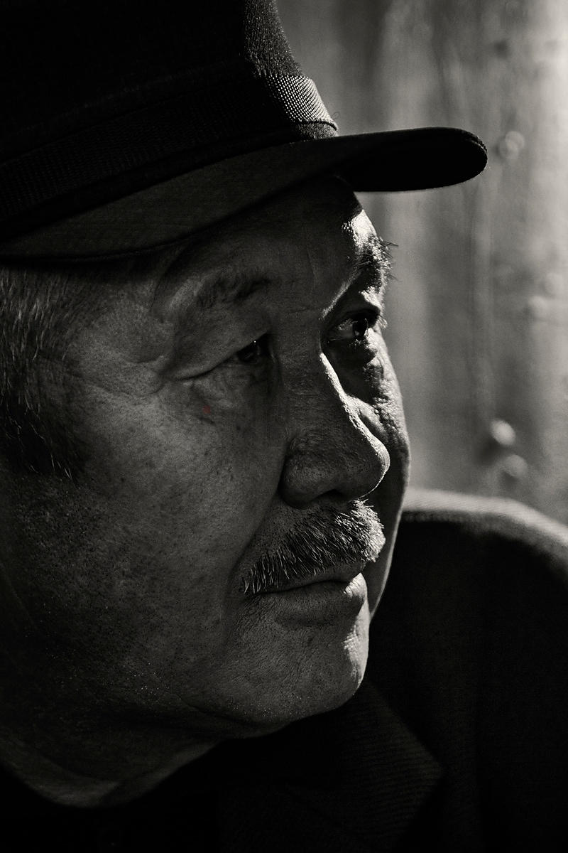Portrait of a Store Vendor at the Osh Bazaar