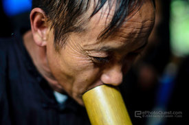 Black Hmong Man Smoking a Pipe