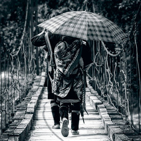 Hmong Woman and Child on Bridge with Umbrella