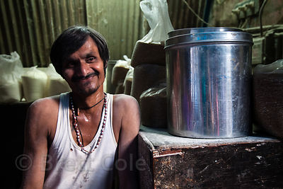 A worker in a sweet shop in the Dharavi slum, Mumbai, India.