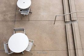 Overlook of chairs and tables on patio in Century City, Los Angeles, CA.