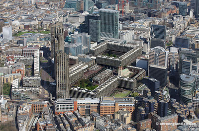aerial photograph of the Barbican  London England UK showing Lauderdale Tower, London EC2Y 8BY, Shakespeare Tower, Barbican, London EC2Y 8ND, St Giles-without-Cripplegate Church , City of London School for Girls.Barbican, London EC2Y 8BB ,Aldersgate St, London EC1A 4DD , Beech St, London EC2Y 8AD  and the Barbican Centre, Silk St, London EC2Y 8DS