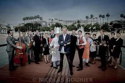 Dominique Desseigne, CEO of Groupe Lucien Barrière, poses for a photo with all trades in the hotel Majestic Barriere in Canne...