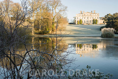 Kingston Maurward House viewed from beyond the lake. Kingston Maurward Gardens, Dorchester. Dorset, UK
