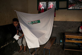 a man comes out of the voting booth at a polling station of Isotry district in Antananarivo, on November 7, 2018 during the f...