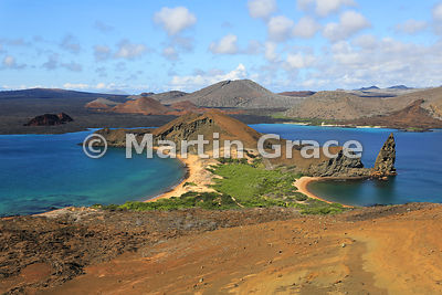 The classic view from the summit viewpoint of Bartolome Island across the western end of Bartolome and Sullivan Bay to the la...