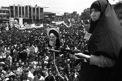 Iranian Armed woman on guard and participating in Khordad in one of the main squares in Tehran at the beginning of the Irani...