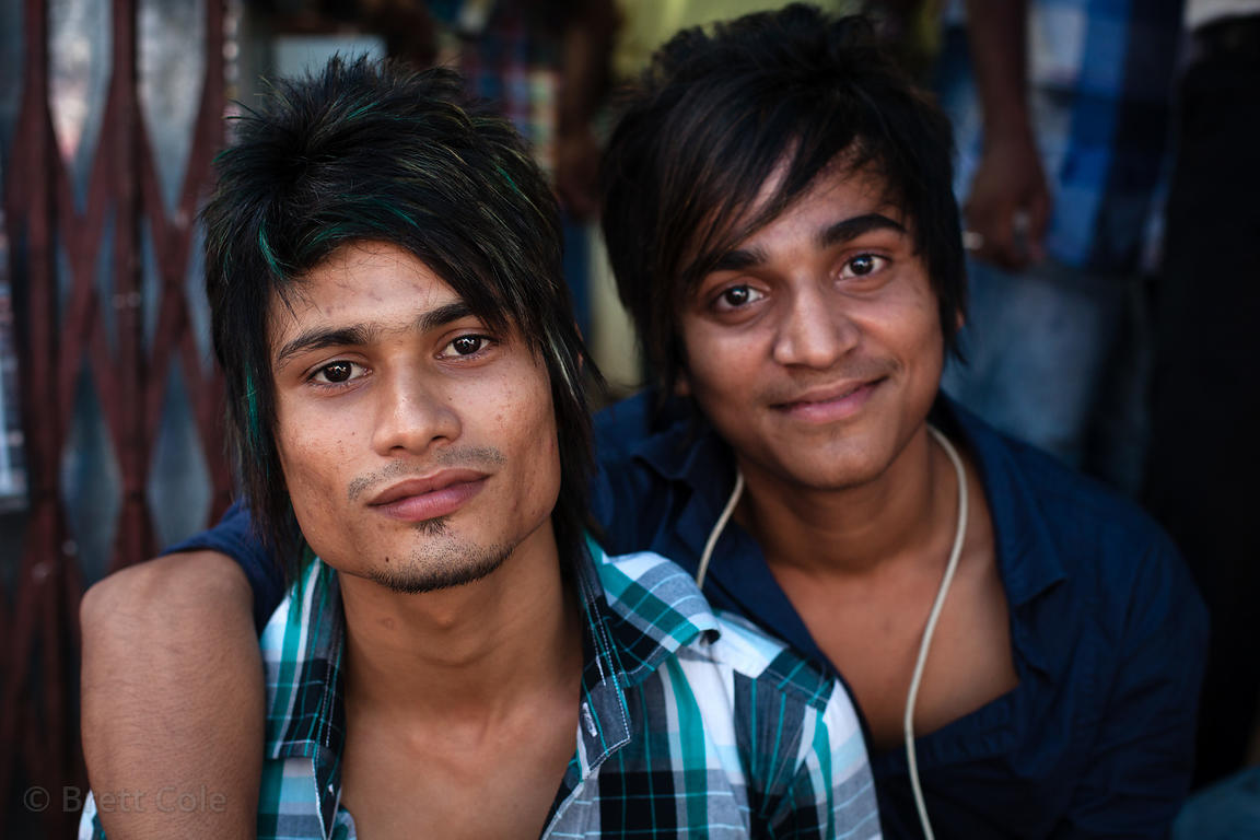 Portrait of two men working at a cell phone repair shop in Crawford Market, Mumbai, India.