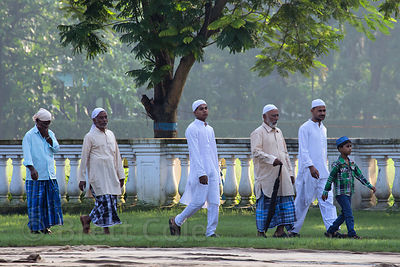 A Muslim family walks to the attend the Eid al-Adha, Red Road, Madian, Kolkata, India. I have the only photos taken by a fore...
