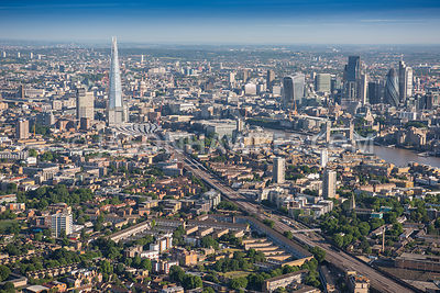 Aerial view of London, Borough with Tower Bridge towards City of London skyline.