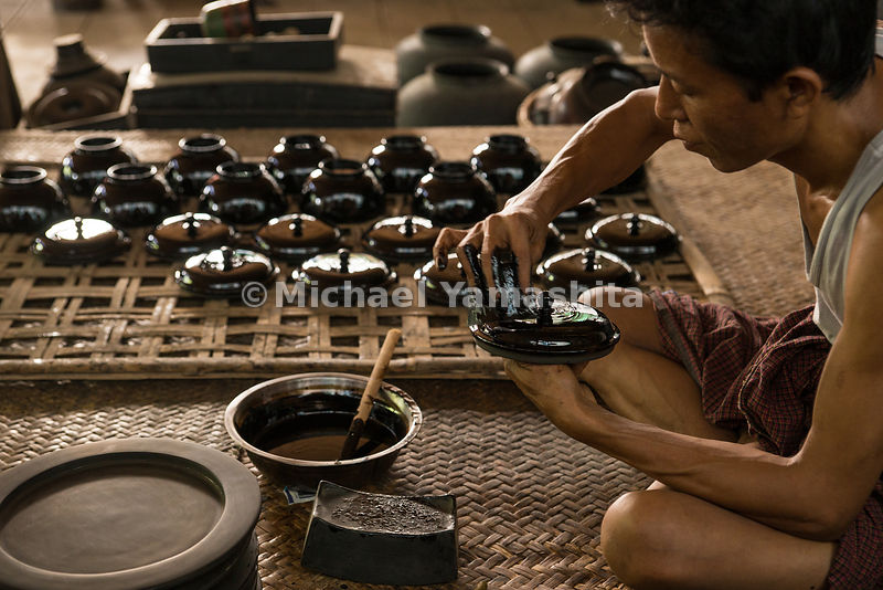 Workers at the U Ba Nyein lacquer shop in Bagan. Here, lacquerware is prepared as it has been for centuries. A varnish made o...