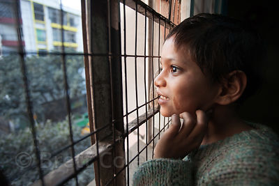 A girl at a shelter for homeless or otherwise at-risk girls in Amader Bari, Kolkata, India. She had just arrived at the shelt...