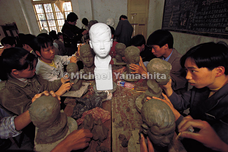 Pupils of the ceramics school in Dehua - where the best porcelain in China is produced - copy the bust of a Western boy.