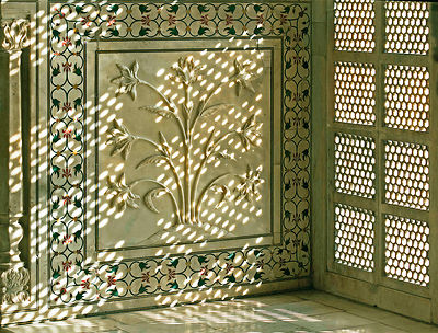 This intricate pattern of a beautifully carved ivory - white marble with inlay work and jali work represents India's finest a...