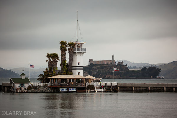View from Pier 39 towards Alcatraz with Forbes Island in the foreground in San Francisco, California, USA