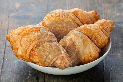 Croissants on wooden table