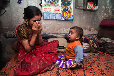 A mother plays peek-a-boo with her baby at their house in the Fakir Bagan neighborhood of Howrah, India, in an area served by the NGO Calcutta Kids (calcuttakids.org)
