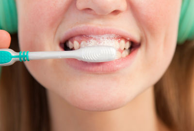 Close up of girl brushing her teeth