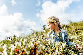 Girl picking sea buckthorn in Thy, Denmark 6