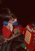 Child Talking On Toy Phone