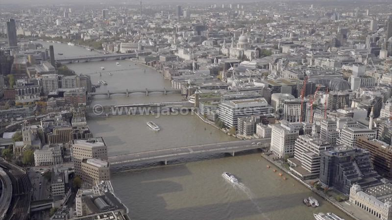 Aerial footage of the River Thames and the City of London