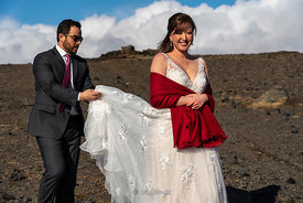 A newly-wed couple at the southern coast of Iceland near the Dyrhólaey Lighthouse near the town of Vík.