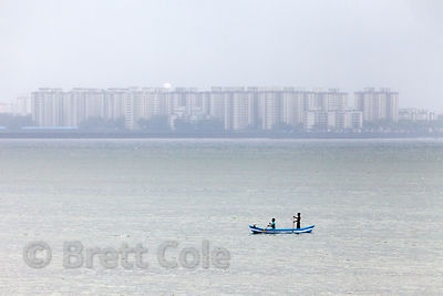 A fishing boat in mist and rainclouds on Back Bay (Arabian Sea), Mumbai, India.