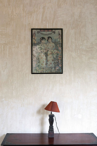 A lampshade and an antique painting in The Villa Helena, an upscale Heritage Hotel, Pondicherry, India
