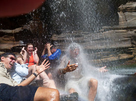 Tourists going under the King George Falls on the King George River in Australia's Kimberley.