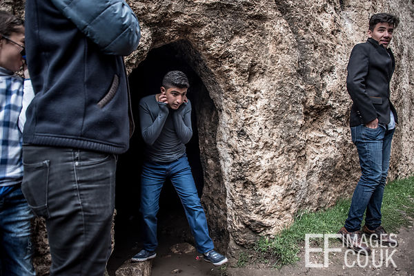 A Kid Exits A Cave In Which He And His Friends Have Been Setting Off Fireworks