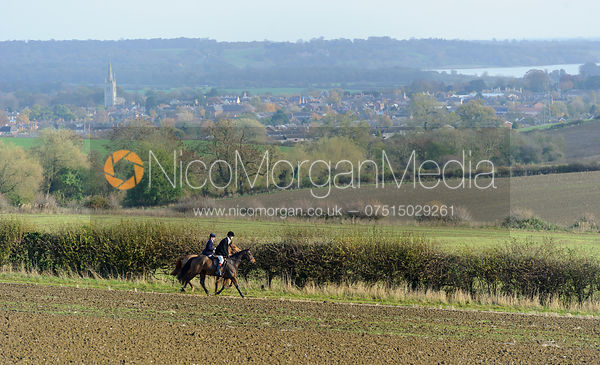 Two followers above Oakham and Rutland Water - The Cottesmore Hunt at Braunston, 12-11-13.