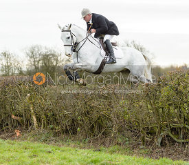Andy Brown jumping a hedge on Graham Smith's