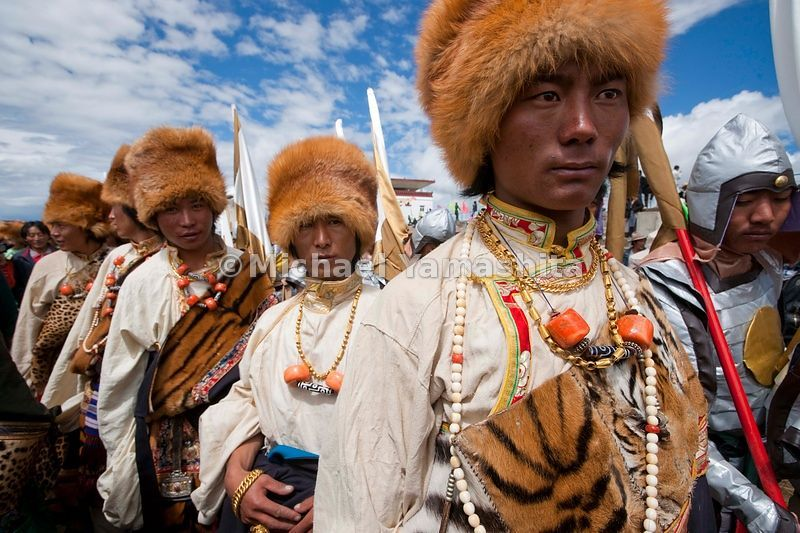 Not to be outdone by the ladies, these men wear heirloom costumes made with leopard and tiger skins and red fox fur hats.